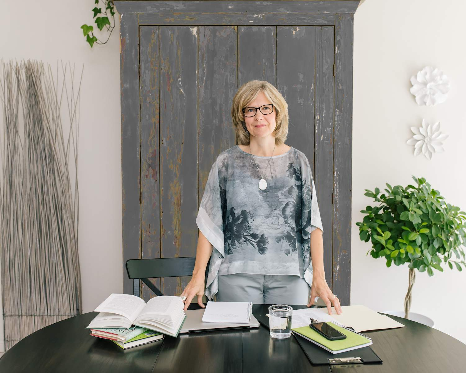 Nel Slater standing at a desk